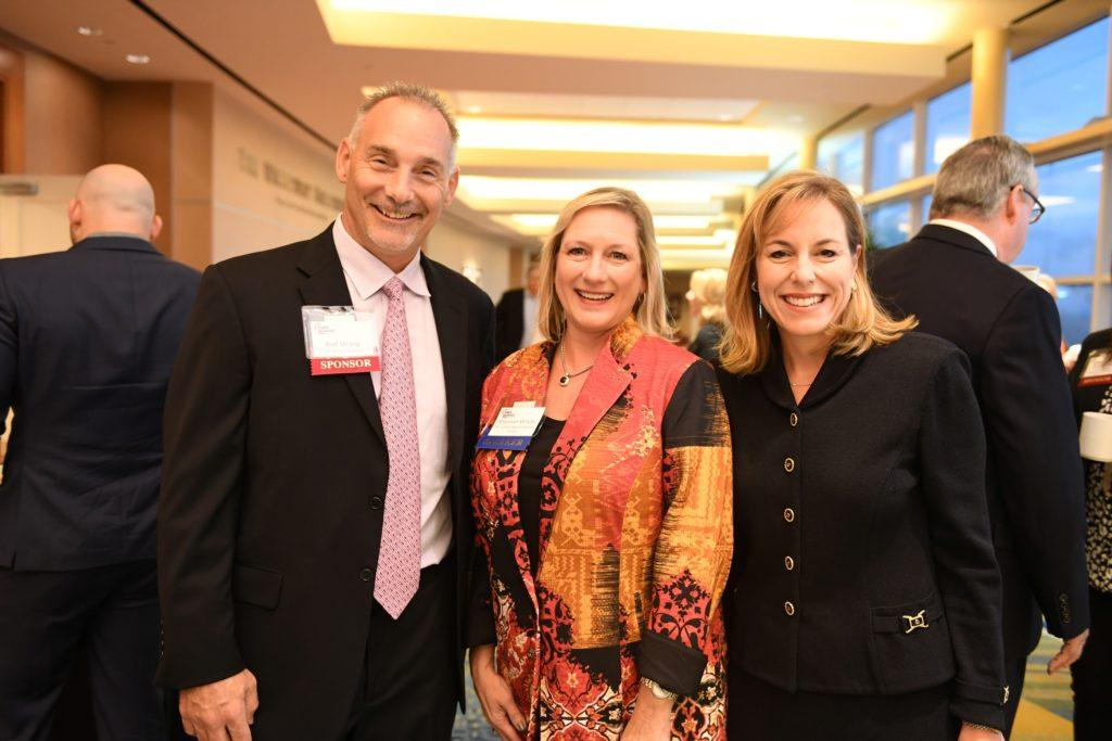 Bret Strong (left) of The Strong Firm, along with Shannon Wilson with The Cynthia Woods Mitchell Pavillion, and Debra Sukin (right) with Houston Methodist The Woodlands pose for a picture at The Woodlands Power Breakfast held on October 7 at The Woodlands Waterway Marriott Hotel & Convention Center. Photo credit: Daniel Ortoz at The Houston Business Journal.