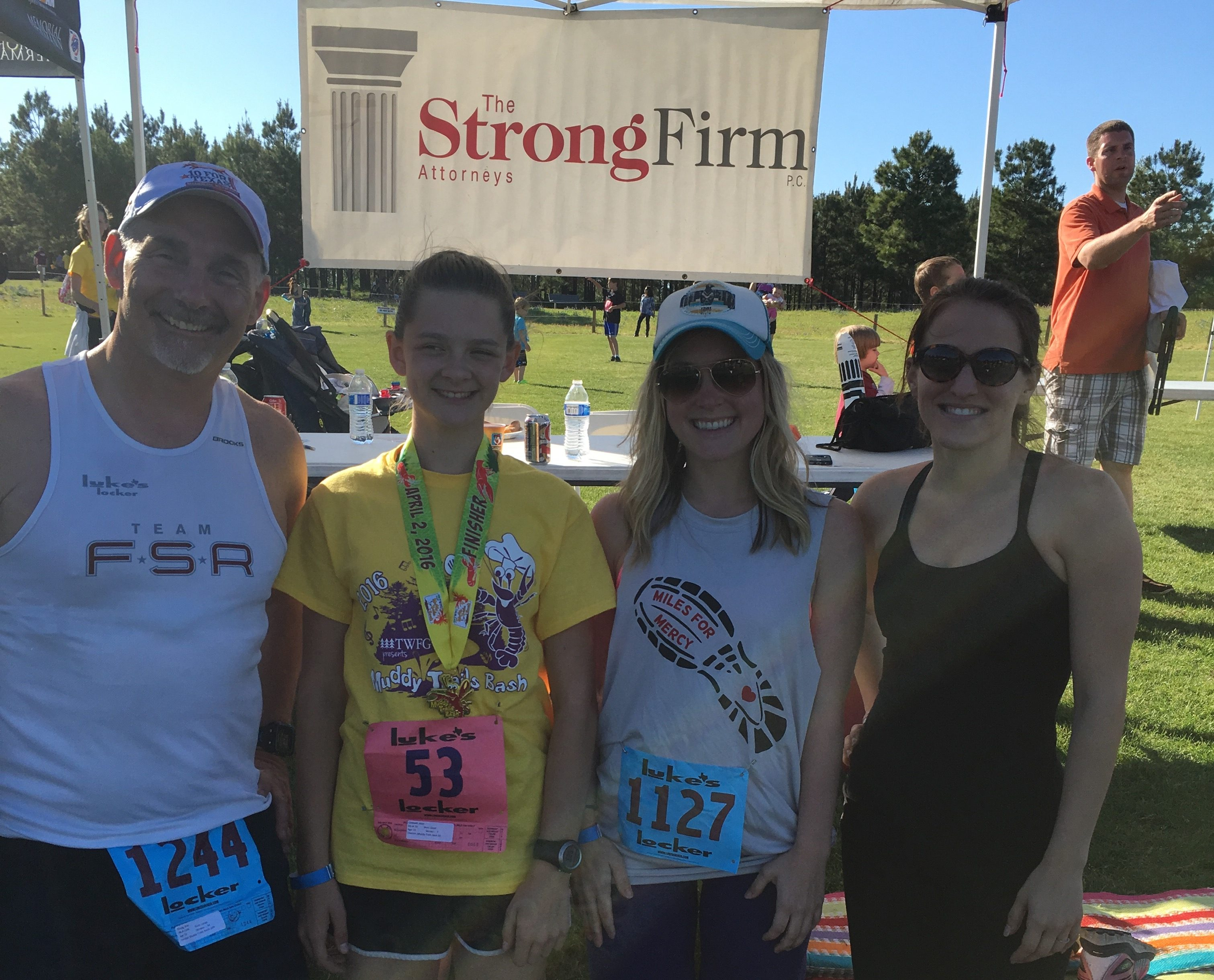 The Strong Firm sponsored and participated in the annual Muddy Trails Bash held at Rob Fleming Park on April 2, 2016. Shown from left to right are Bret Strong, Alexi Caldwell, Bethany Kovacs and Laura Davis.