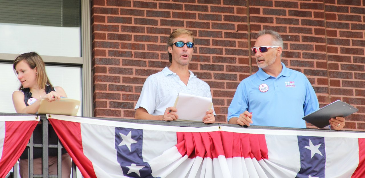 Bret Strong, shareholder of The Strong Firm PC (shown right), Josh Urban, CEO of Memorial Hermann The Woodlands (shown center), and Jessica Fraser, CEO of Woodlands Online (shown left) serve as judges together at the South Montgomery County 4th of July Parade held on Saturday, July 4th, 2015