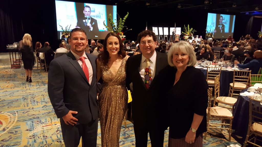 We were proud to be a Music Sponsor at Children's Safe Harbor's Gala this past week where Donoho's Jewellers was also a sponsor. We were able to snag a picture of Bart and Courtney West (co-director of Donahoe's) along with Steve Glazer (co-director of Donahoe's) and Renee Levey Glazer (paralegal at The Strong Firm P.C.).